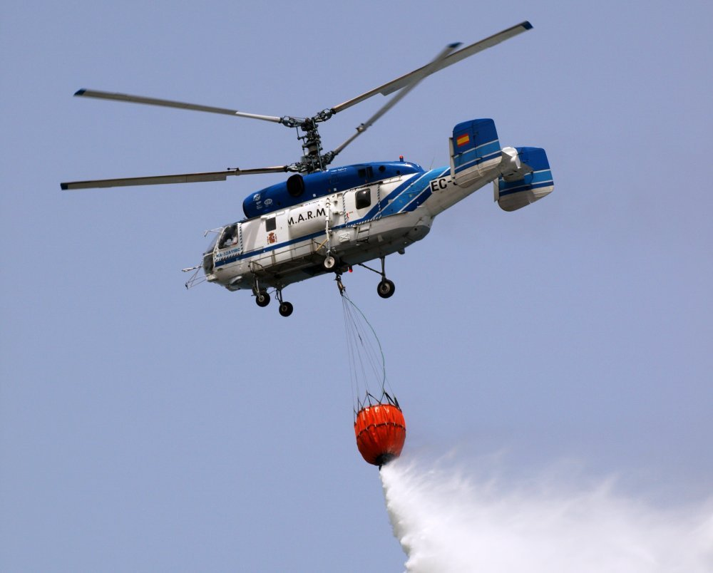 Kamov helicopter dropping water