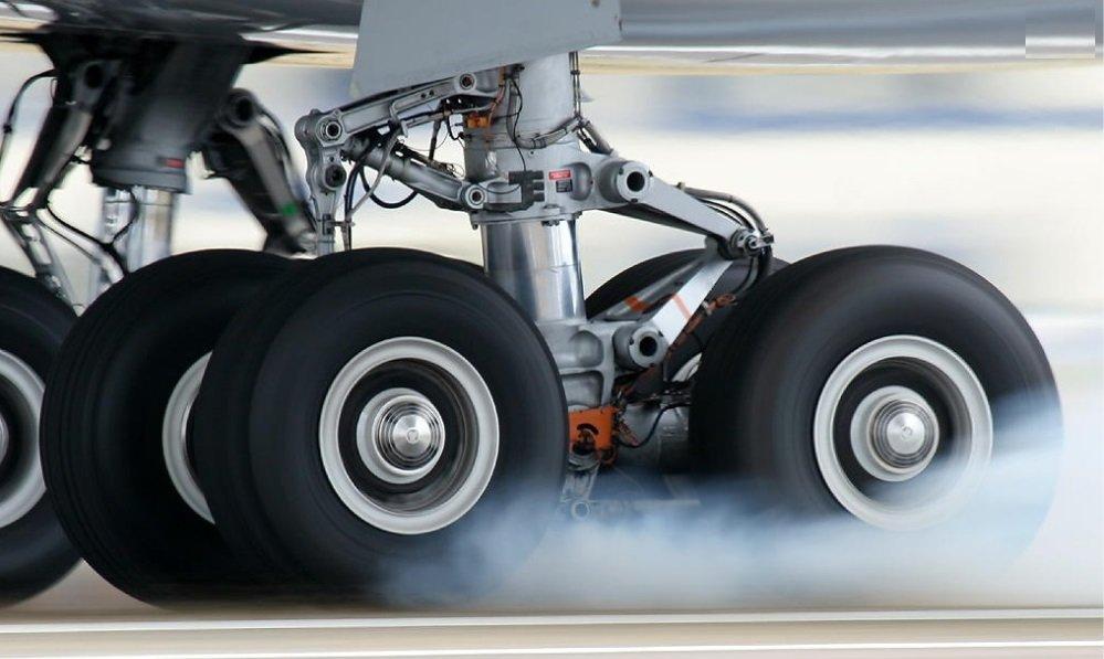 Landing gear smoking upon impact